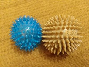 Two variations of the BarkBox spiked ball